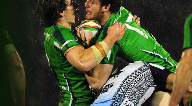 Ireland's Anthony Mullally (right) collides with his team-mate Rory Kostjasyn as he is tackled by Fiji's Apisai Koroisau during the 2013 World Cup match at Spotland