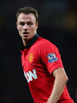 Manchester United v Liverpool - Capital One Cup Third Round...MANCHESTER, ENGLAND - SEPTEMBER 25: Jonny Evans of Manchester United in action during the Capital One Cup Third Round match betwen Manchester United and Liverpool at Old Trafford on September 25, 2013 in Manchester, England. (Photo by Julian Finney/Getty Images)...S