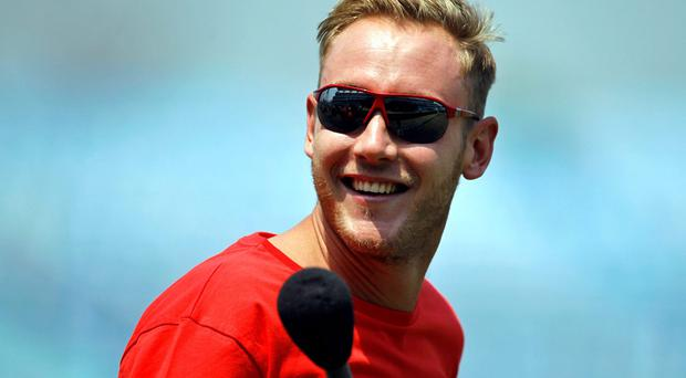 England's captain Stuart Broad smiles holding a microphone during a training session ahead of their ICC Twenty20 Cricket World Cup match against Sri Lanka in Chittagong, Bangladesh, Sunday, March 23, 2014. (AP Photo/A.M. Ahad)