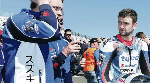 Calm and collected: William Dunlop talks to his Tyco Suzuki team-mates during practice yesterday