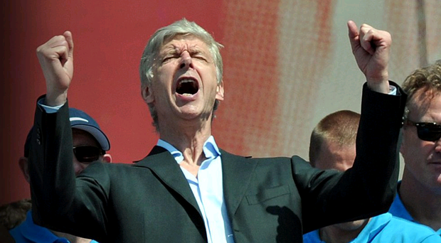 Arsenal manager Arsene Wenger celebrates outside the Emirates Stadium during the FA Cup winners parade in London. PRESS ASSOCIATION Photo. Picture date: Sunday May 18, 2014. See PA Story SOCCER Arsenal. Photo credit should read: Anthony Devlin/PA Wire