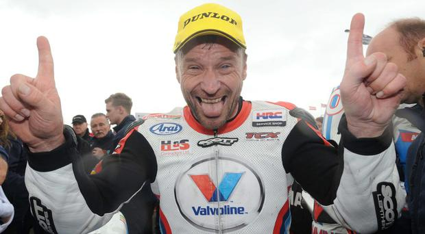 Bruce Anstey celebrates victory in the opening Supersport race during todays races at the 2014 Vauxhall International North West 200 on the North Coast