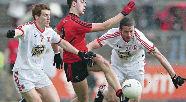 Danger man: Stephen O'Neill (right) was a late introduction to Tyrone's 2-11 to 3-08 draw with Down at Healy Park