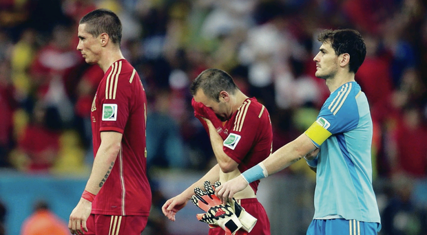 Dream over: Spain's Fernando Torres, Andres Iniesta and goalkeeper Iker Casillas after the defeat to Chile