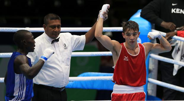 Michael Conlan, pictured in red, is one of nine Northern Irish boxers guaranteed at least bronze