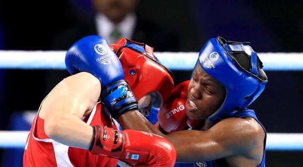 England's Nicola Adams, right, had a tough battle against Michaela Walsh, left