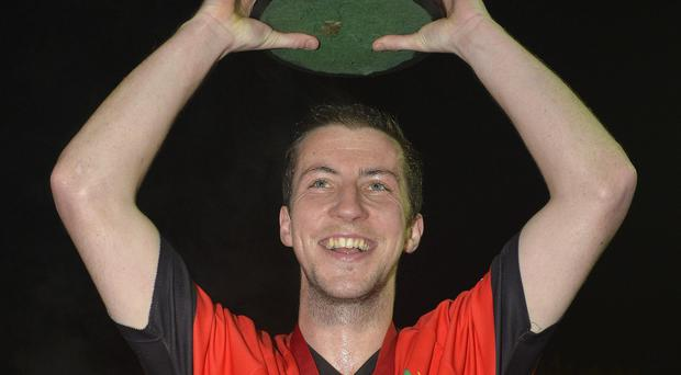 Prize guy: Colin Henning lifts the Linden Cup, just one of two hockey titles unbeaten Newry Olympic managed to obtain