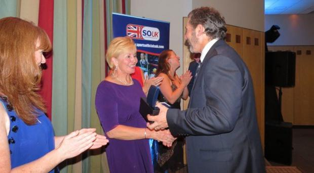 Major prize: Pam Brown accepts her award in England