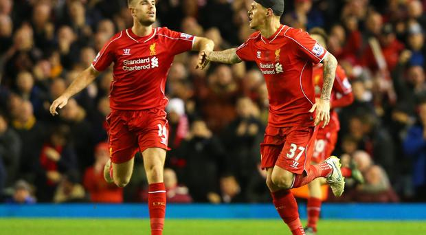 Late point: Jordan Henderson (left) congratulates Martin Skrtel after his stoppage time equaliser on Sunday