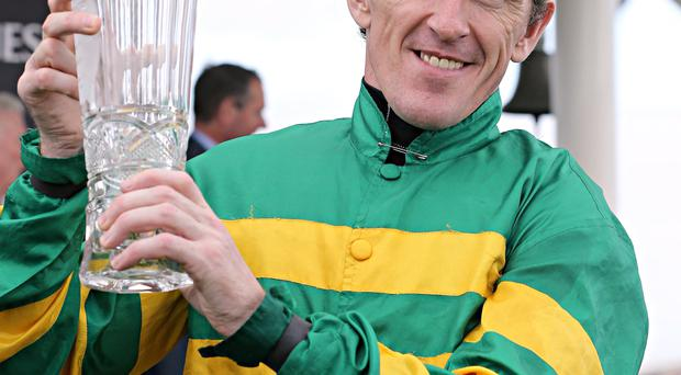 Out on a high: Tony McCoy may be thinking about bowing out while he's on top