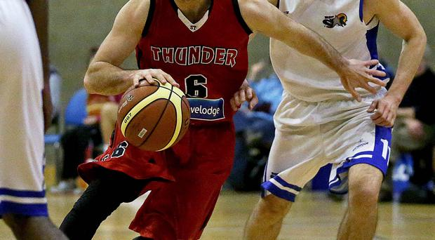 Class act: Brian McCotter (right) in action for Belfast Star