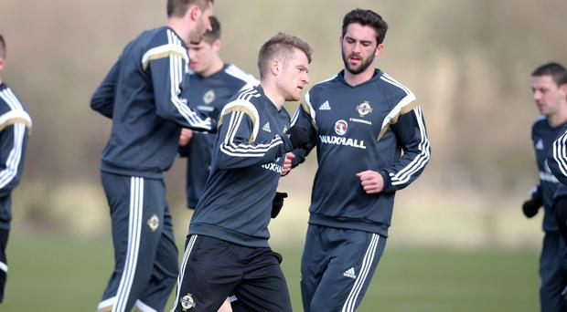 Training camp: Northern Ireland skipper Steven Davis is put through his paces in Scotland with his team-mates
