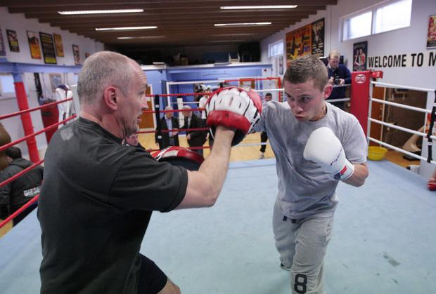 Packing a punch: Carl Frampton trains with Barry McGuigan