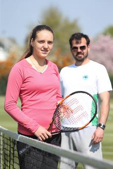 Rising star: Karola Bejenaru with coach Przemek Stec at Windsor Tennis Club, Belfast