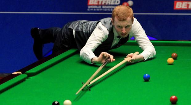 Anthony McGill in action against Mark Selby during day seven of the Betfred World Championships at the Crucible Theatre Sheffield
