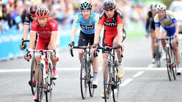 Team Sky's Lars-Petter Nordhaug, centre, crosses the line to secure overall victory in Leeds