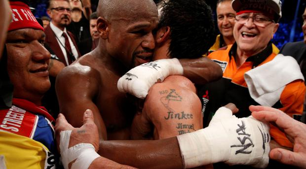 Floyd Mayweather embraces Manny Pacquiao after their clash