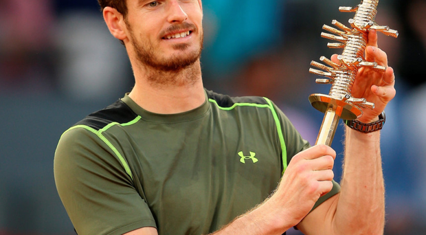 Title joy: Andy Murray lifts the Madrid Masters trophy after crushing Rafael Nadal in the final