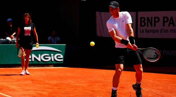 Into the swing: Andy Murray gears up for his French Open semi-final against Novak Djokovic