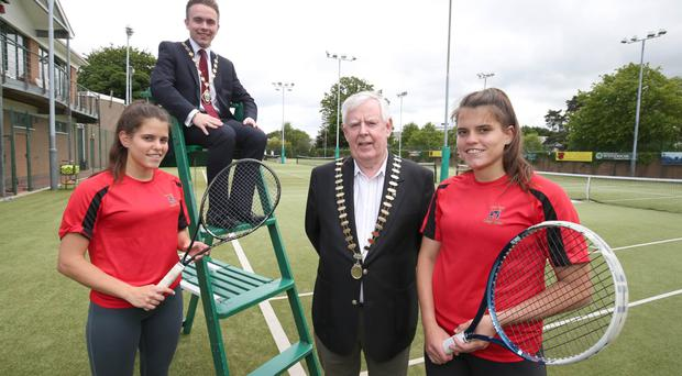 Deputy Lord Mayor of Belfast is Alderman Guy Spence along with Tennis Ireland President George Stevenson MBE and sisters Caitlin and Annie McCullough at the launch of the ITF Tennis Tournament that is due to take part at Windsor tennis club