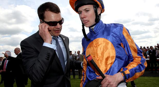 Family affair: champion trainer Aidan O'Brien with jockey son Joseph