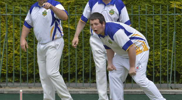 Bowled over: Matthew Crawford of Bangor anticipates the outcome as a bowl enter the head