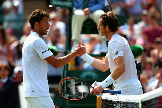 Quick finish: Robin Haase congratulates Andy Murray after the Briton's straight sets win
