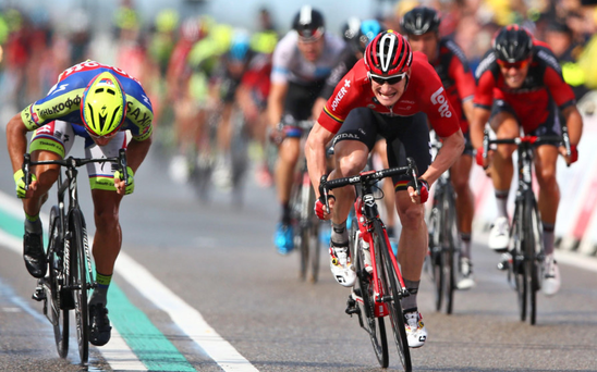 Tight finish: Andre Greipel (right) crosses the finish line ahead of Peter Sagan with Mark Cavendish (far right) back in fourth