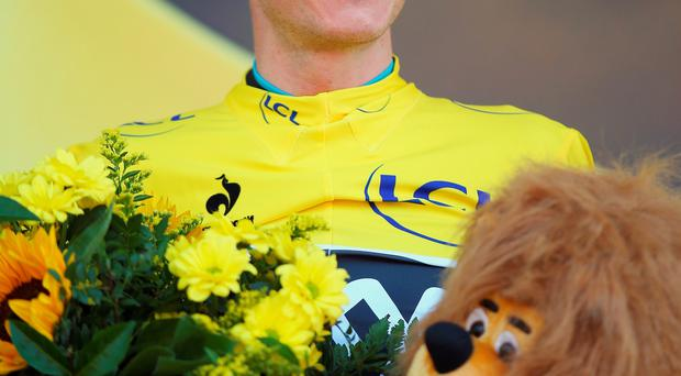 Follow the leader: Chris Froome with the yellow jersey