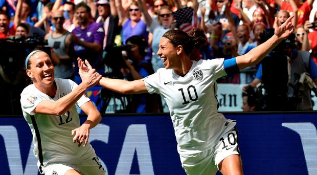 On top of the world: Carli Lloyd (10) celebrates the second of her three goals in the USA's World Cup final victory over Japan