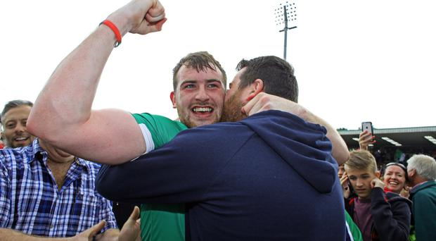 In the family: Sean Quigley is hugged by brother Seamus after the Erne County's late win over Roscommon