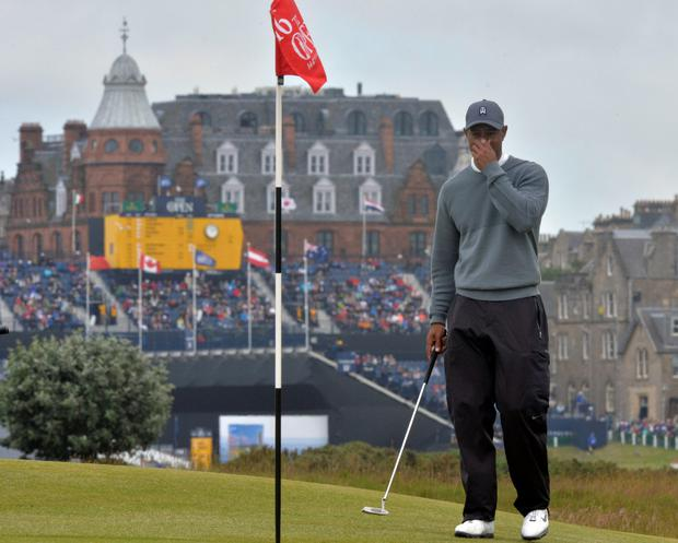 Dejected Tiger: Woods endured a bad day at the office