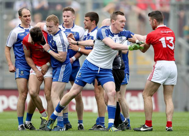 Gripping: Tyrone and Monaghan players get shirty