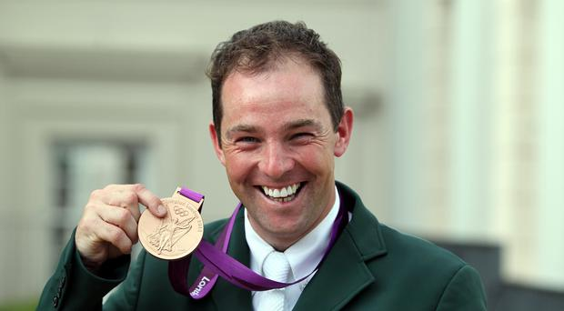 Irish showjumper Cian O'Connor, pictured with his bronze medal won at the London 2012 Olympics