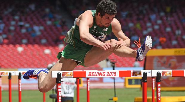 Aiming high: Ben Reynolds on his way to a time of 13.72 in his 110m hurdles heat at the World Championships in Beijing
