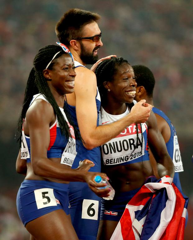 Double joy: Great Britain's men and women's 4x400m relay teams celebrate their bronze medals