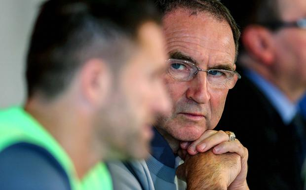 Retain focus: Martin O'Neill, alongside Robbie Keane, ponders the Republic's Euro 2016 prospects yesterday in Faro