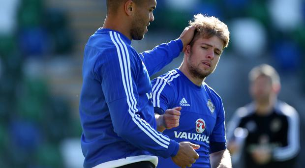 Alright pal: Josh Magennis and Jamie Ward during Northern Ireland training ahead of the Euro showdown with Greece