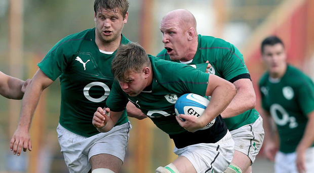 Battering ram: Chris Henry (left) helps Jordi Murphy drive forward with some help from Paul O'Connell (right)