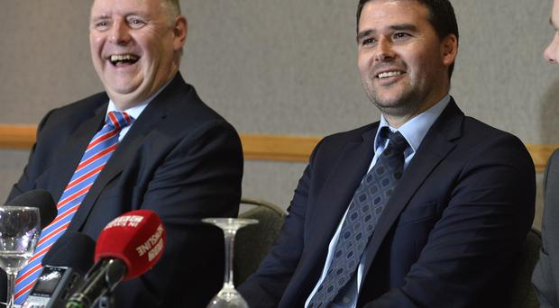 All smiles: Linfield board member Jack Grundie and new boss David Healy share a joke at the latter's unveiling as manager