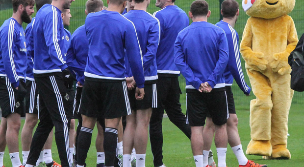 In need of a laugh: Pudsey Bear joins the players in training