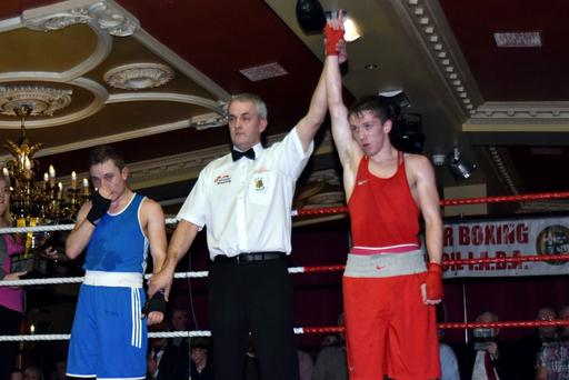 Prize fighter: TJ Waite has his arm raised as he is crowned Ulster Elite flyweight king
