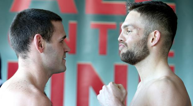 Facing off: Belfast duo Fredo Meli and Conrad Cummings weigh in ahead of their Celtic middleweight title clash at the Waterfront