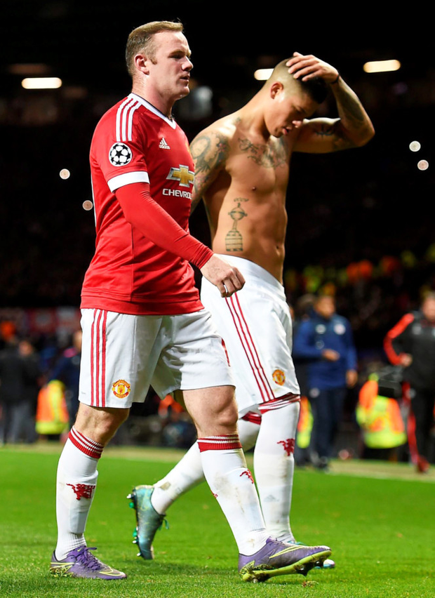 bee7d02fc48 Dejection  Wayne Rooney and Marcus Rojo leave the pitch after last night s  0-0