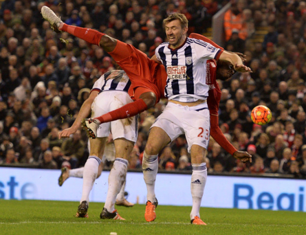 Christian Benteke tumbles behind West Bromwich Albion defender Gareth McAuley