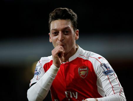 Red hot: Arsenal's German midfielder Mesut Ozil