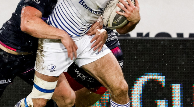 Tough test: Leinster's Dave Kearney battles through