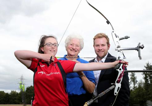 Winner: Dame Mary Peters and Rainbow Communications' Stuart Carson congratulate Megan Bryer on receiving the Rainbow Communications Sports Award
