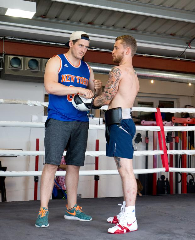 Shane McGuigan and Carl Frampton prepare for a training session at their London base