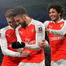 Rocking out: Arsenal ace Olivier Giroud celebrates his opener, a day after his partner gave birth